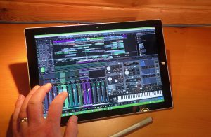Hand operating Studio One 3 on a Surface Pro