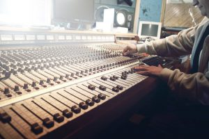 Music producer at mixing desk